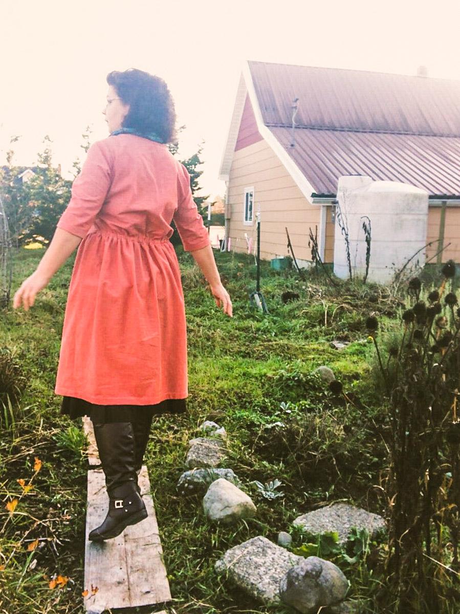 Woman walking in garden wearing hinterland dress