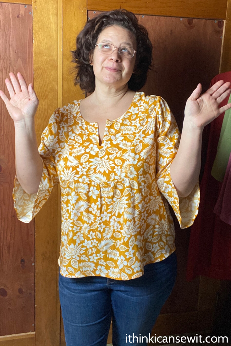 Woman showing Phoenix blouse bell sleeves