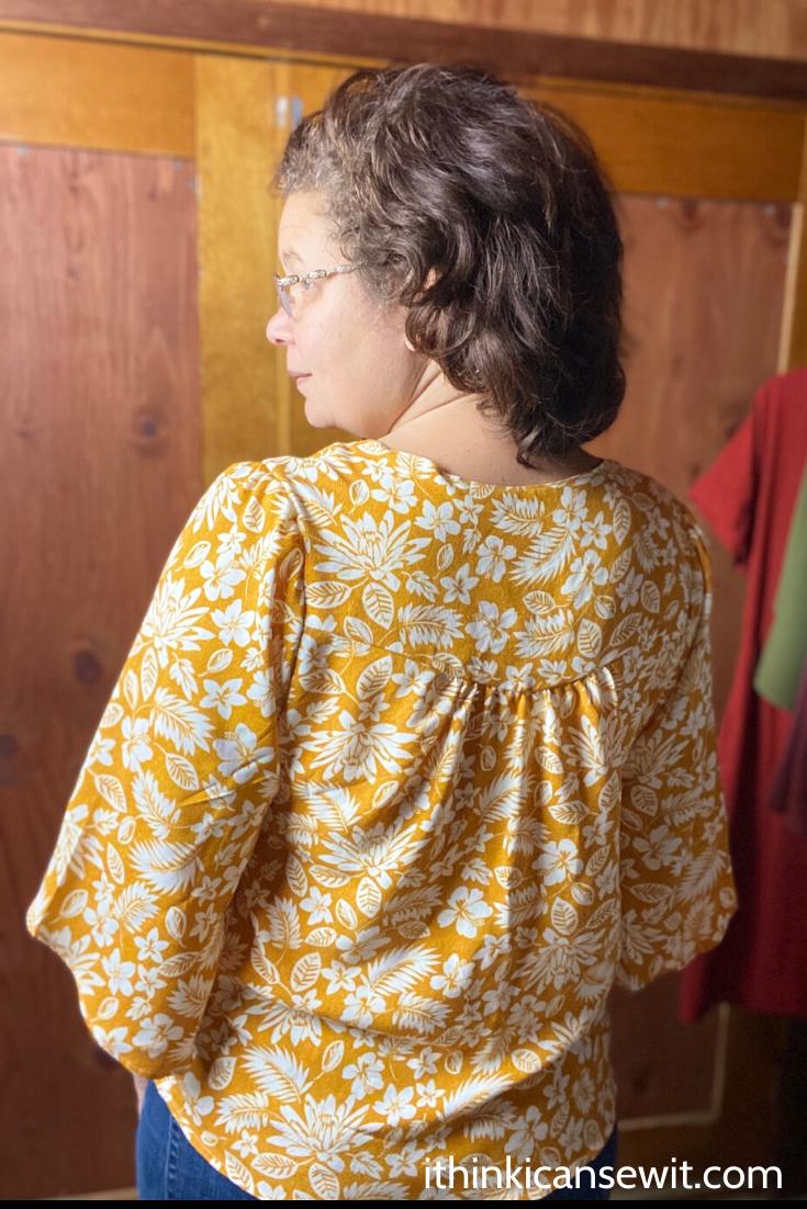 Woman showing Phoenix blouse back view